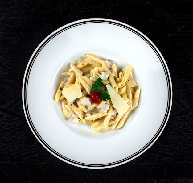 Pasta in cream sauce with chicken and parmesan Free Photo