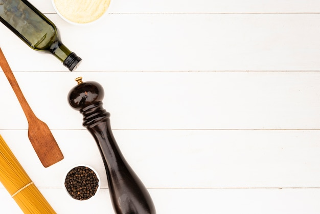 Pasta ingredient and kitchen utensil on white background Free Photo