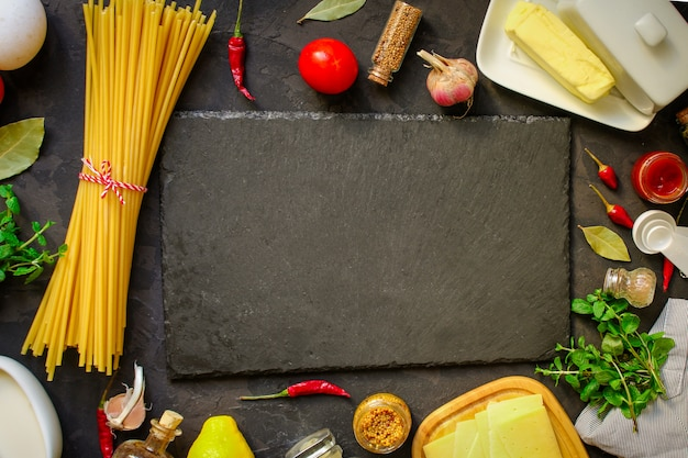 Pasta, spaghetti or bucatini and tomato sauce ingredients. food background. copy space Premium Photo