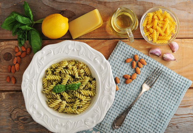 Pasta spirals with cheese, almonds and basil Premium Photo