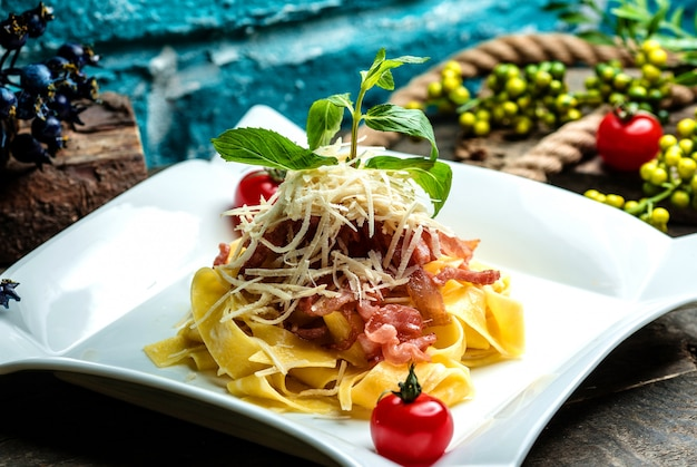 Pasta topped with cheese and herbs Free Photo