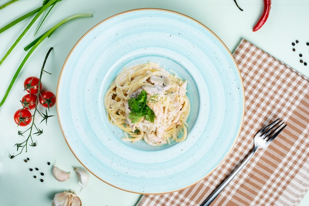 Pasta topped with sour cream and mushrooms Free Photo