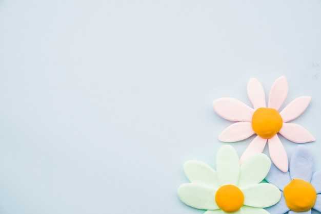 Pastel clay flowers on gray background Free Photo