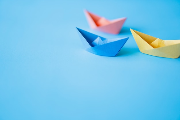 Pastel color paper boat on clean background with copy space Premium Photo