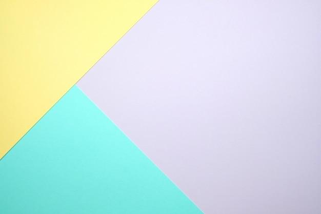 Pastel color paper flat lay  background Premium Photo