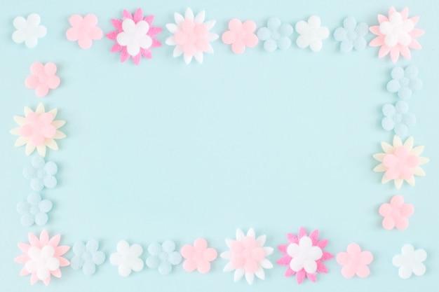 Pastel flower on blue color paper background photo premium download pastel flower on blue color paper background premium photo mightylinksfo