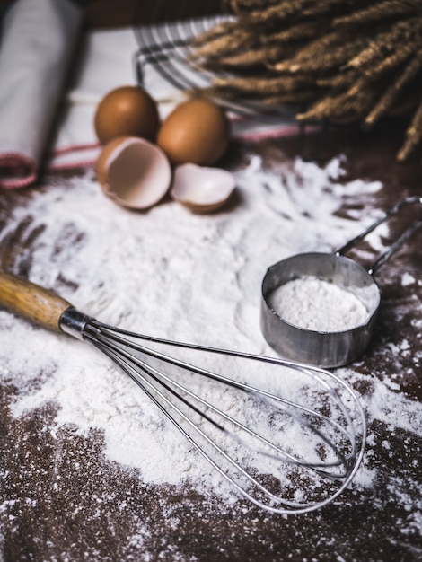 Pastry baking accessories bakery with flour and whisk. Premium Photo
