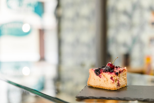 Pastry on shale board over glass counter Free Photo