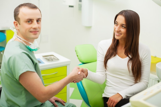 Patient in dentistry. pretty woman visiting her dentist in clinic Premium Photo