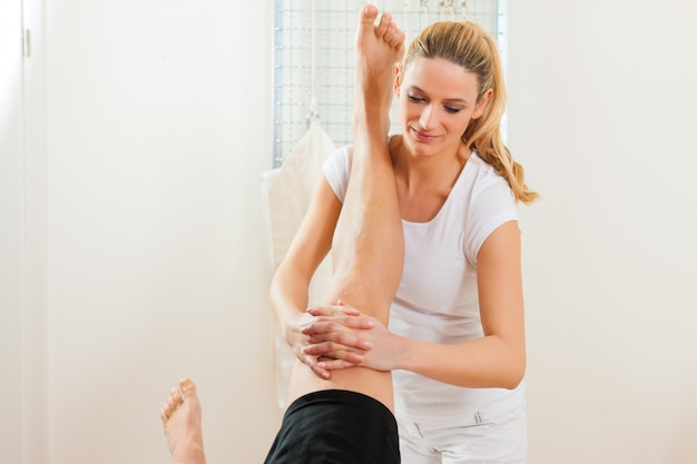 Patient at the physiotherapy doing physical therapy Premium Photo