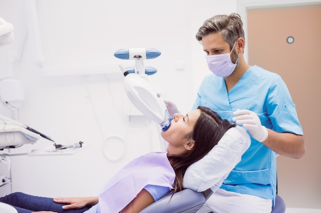 Patient receiving a dental treatment Free Photo