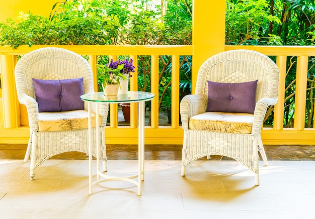 Patio chair and table decoration on balcony Premium Photo
