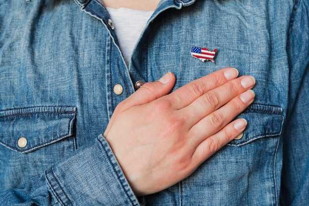 Patriotic person puts hand over heart Free Photo