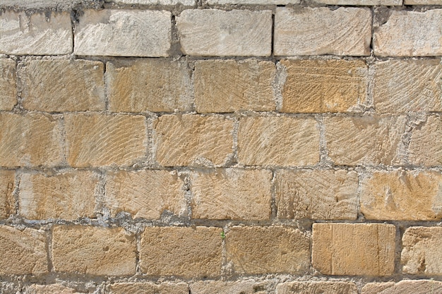 Pattern of chipped stones  wall texture and background Premium Photo