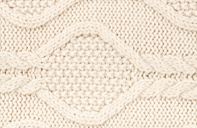 Pattern crocheted with cream wool Free Photo