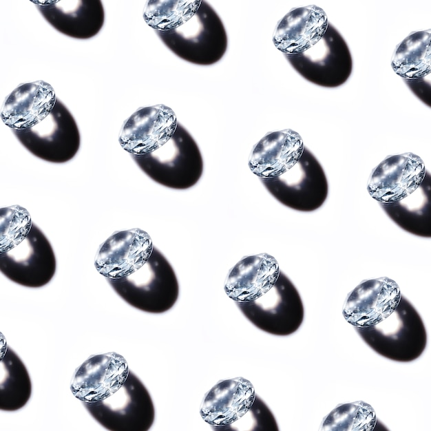 Pattern of crystal diamonds with shadow on white background Free Photo