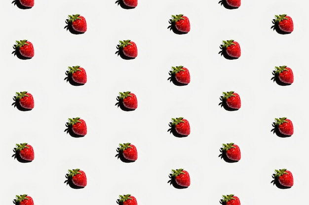 Pattern of delicious strawberries on white surface Free Photo