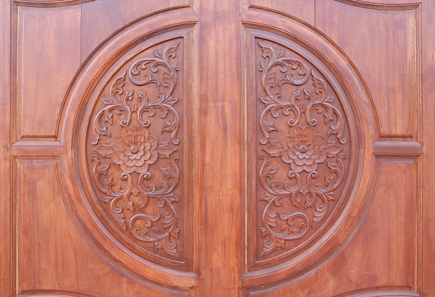 Pattern of flower carved on wood background. traditional wooden thai style Premium Photo
