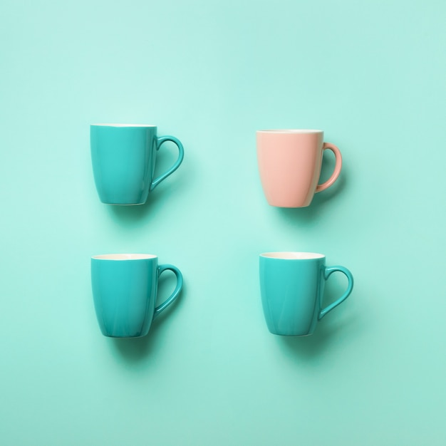 Pattern from blue cups over blue background. square crop. birthday party celebration, baby shower concept. punchy pastel colors. minimalist style design Premium Photo