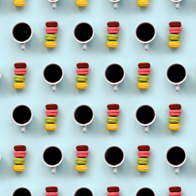 A pattern of many colorful dessert cake macaroon and coffee cups Premium Photo