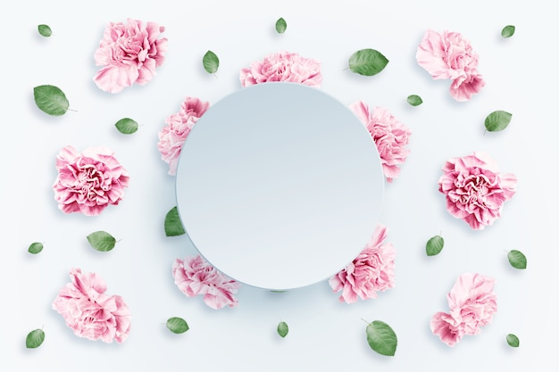 Pattern of pink and beige roses and green leaves on a white background Premium Photo