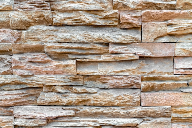 Pattern of stacked stone wall or brick wall texture background Premium Photo