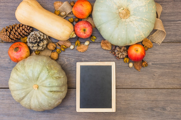 Pattypan squashes with wooden board on table Free Photo