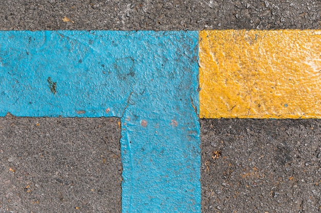 Pavement texture with traffic signals Free Photo