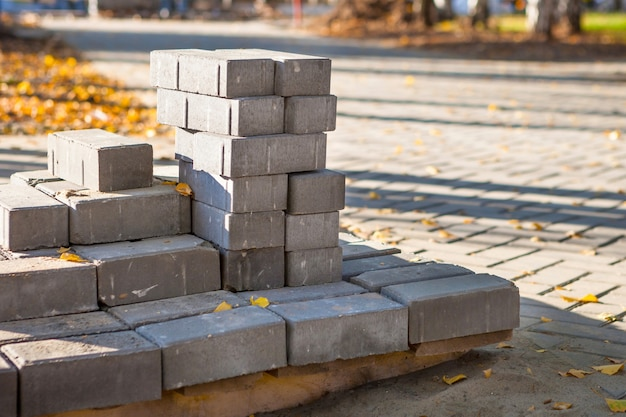 Paving bricks are ready for construction work on pallets for laying paving slabs of the city square
