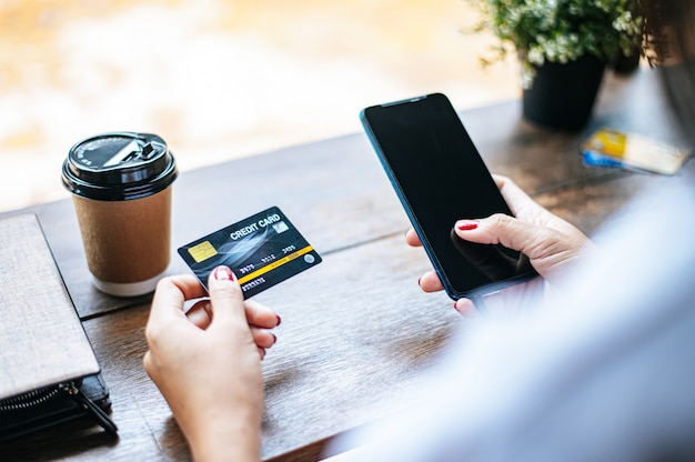 Payment for goods by credit card via smartphone. Free Photo