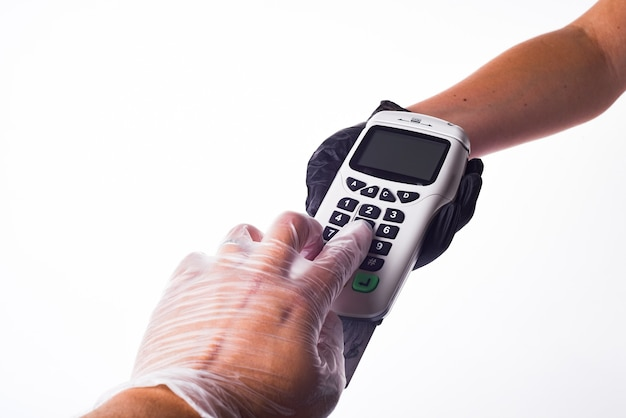 Payment terminal. hands with gloves. seller's hand in a glove. buyer's hand in a glove. safe shopping concept Premium Photo