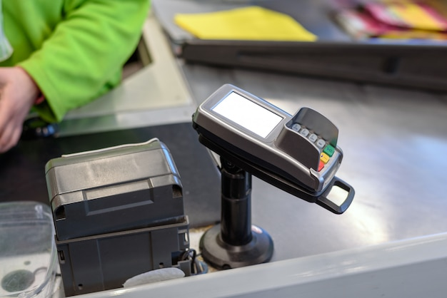 Payment terminal for plastic cards at the store with space for layout, mock up Premium Photo