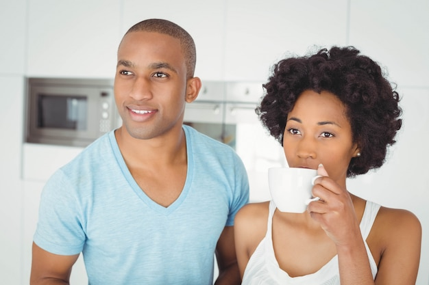 Peaceful couple standing in the kitchen at home Premium Photo