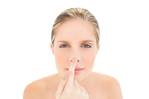 Peaceful fresh blonde woman touching her nose Premium Photo