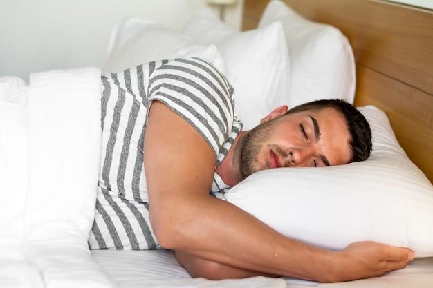 Peaceful man sleeping Free Photo