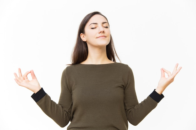 Peaceful tranquil female woman making zen gesture Free Photo
