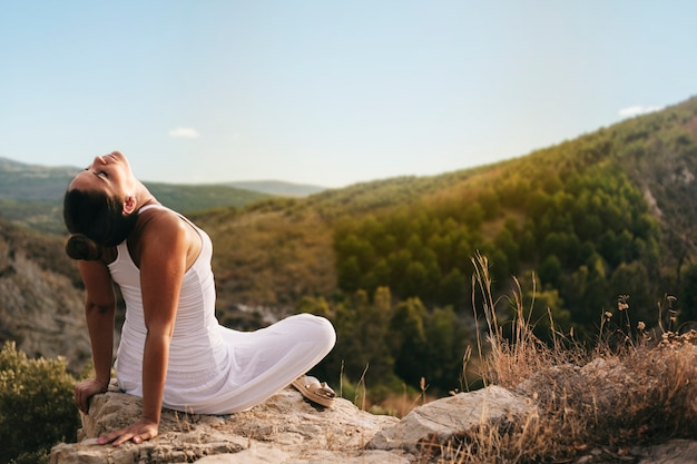 Peaceful woman meditating in countryside Free Photo