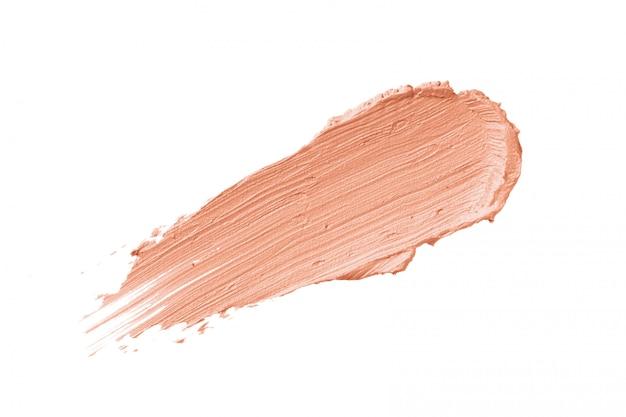 Peach color correcting concealer stroke isolated Premium Photo