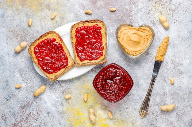 Peanut butter sandwiches or toasts with raspberry jam. Free Photo
