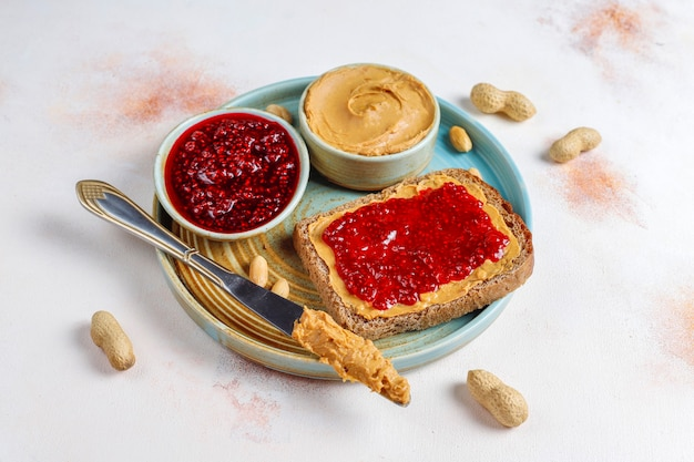 Peanut butter sandwiches with raspberry jam Free Photo