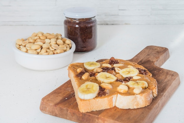 Peanut butter with bread and raspberry marmalade Premium Photo