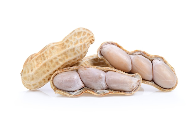 Peanuts isolated on white background. full depth of field. Premium Photo