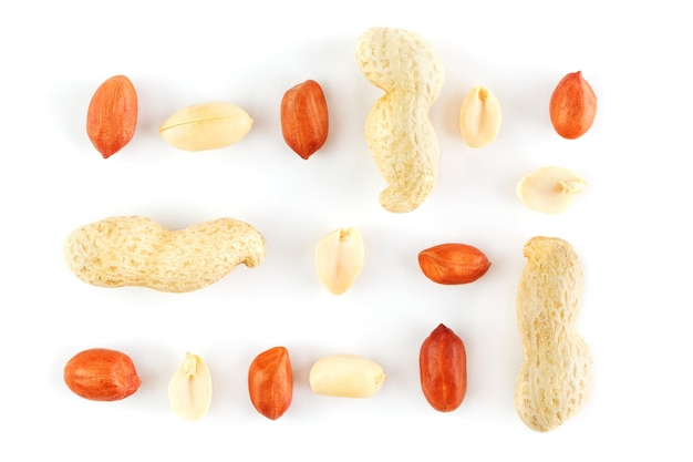 Peanuts isolated on white background. peeled peel and scarlup. Premium Photo