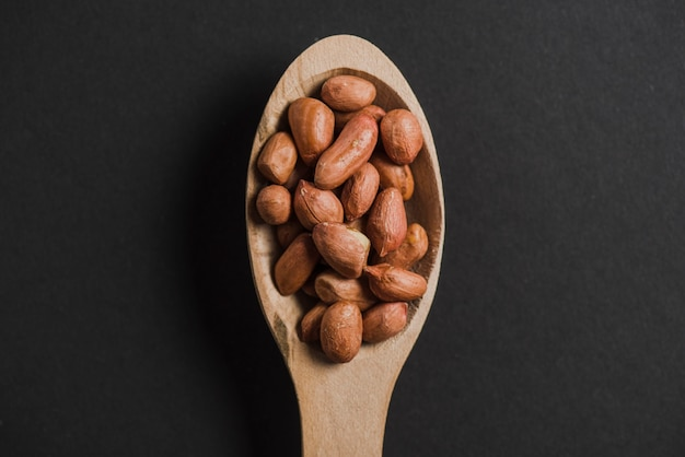 Peanuts in spoon Free Photo