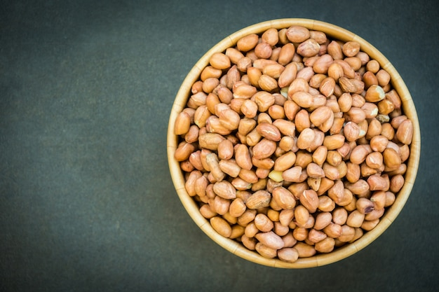 Peanuts in wooden bowl Free Photo