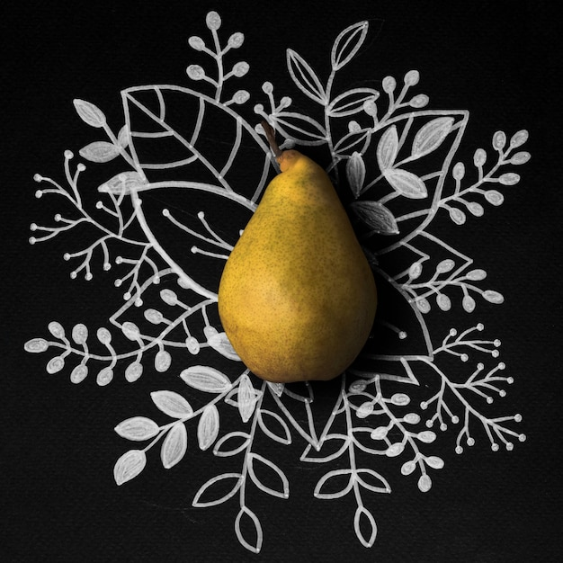 Pear over outline floral table Free Photo