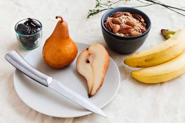 Pears bananas and nuts mix Free Photo