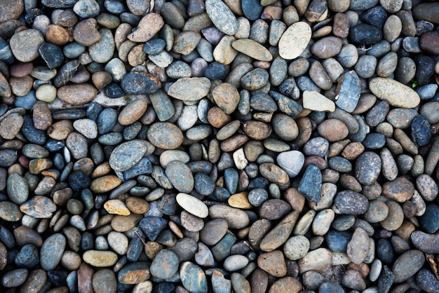 Pebble rocks texture pattern wallpaper Free Photo