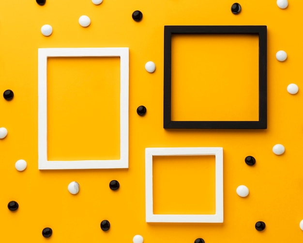Pebbles on yellow background top view Free Photo