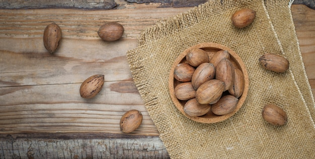 Pecan nuts on rustic, top view Free Photo